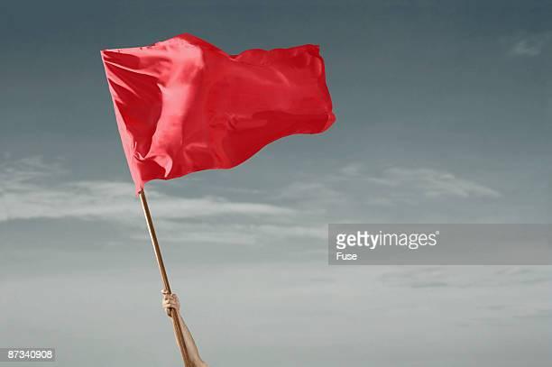 Red Flag against Grey Sky