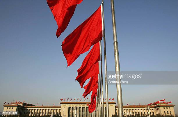 Red flags flutter in front of the Great Hall of the People where the second plenary session of the National People's Congress or parliament was held...