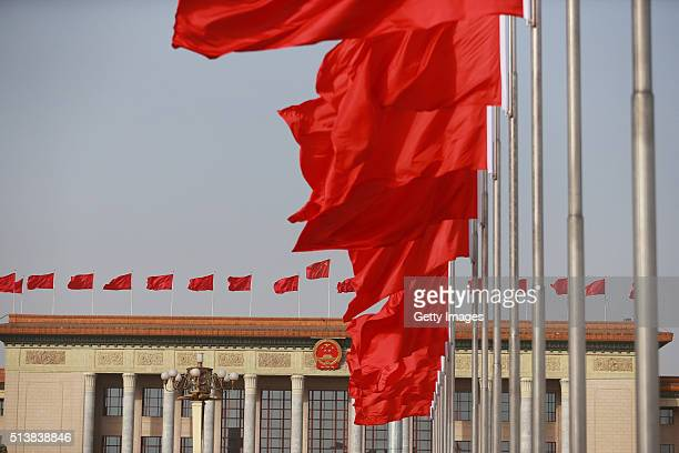 Red flags fly high in front of the Great Hall of the People as the Fourth Session of the 12th National People's Congress opens on March 5 2016 in...