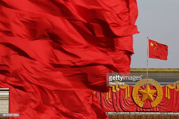 Red flags fly in front of the Chinese national flag right at Tiananmen Gate in Beijing China on Monday March 2 2015 China's annual meeting of the...