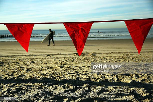 Red flags mark a section of closed beach due to ongoing postSuperstorm Sandy construction along Rockaway Beach on July 31 2013 in the Queens borough...