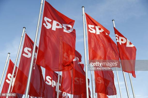 Red flags with the SPD logo float in the wind at the start of the party congress of Germany's Social Democrats party in Berlin on December 7 2017...