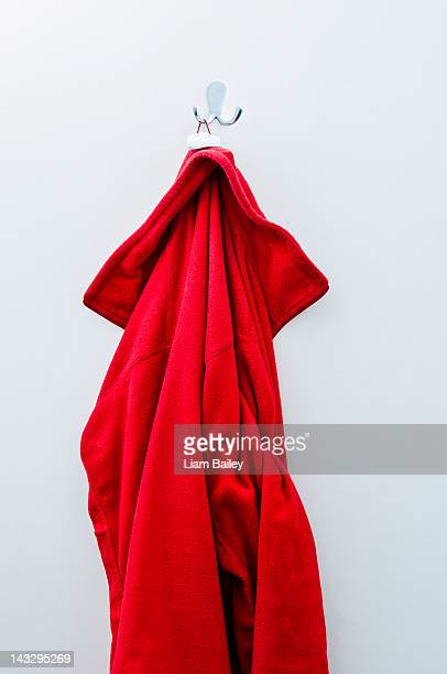 Red fleece jacket hanging on a hook