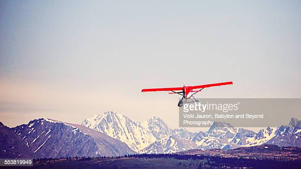 Red Float Plane Against Blue Mountains - Alaska