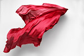 piece of red fabric soaring, art object, design elementflying fabric - high speed studio shot, art object, design element