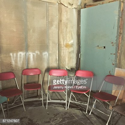 Red Folding Chairs In Abandoned Building