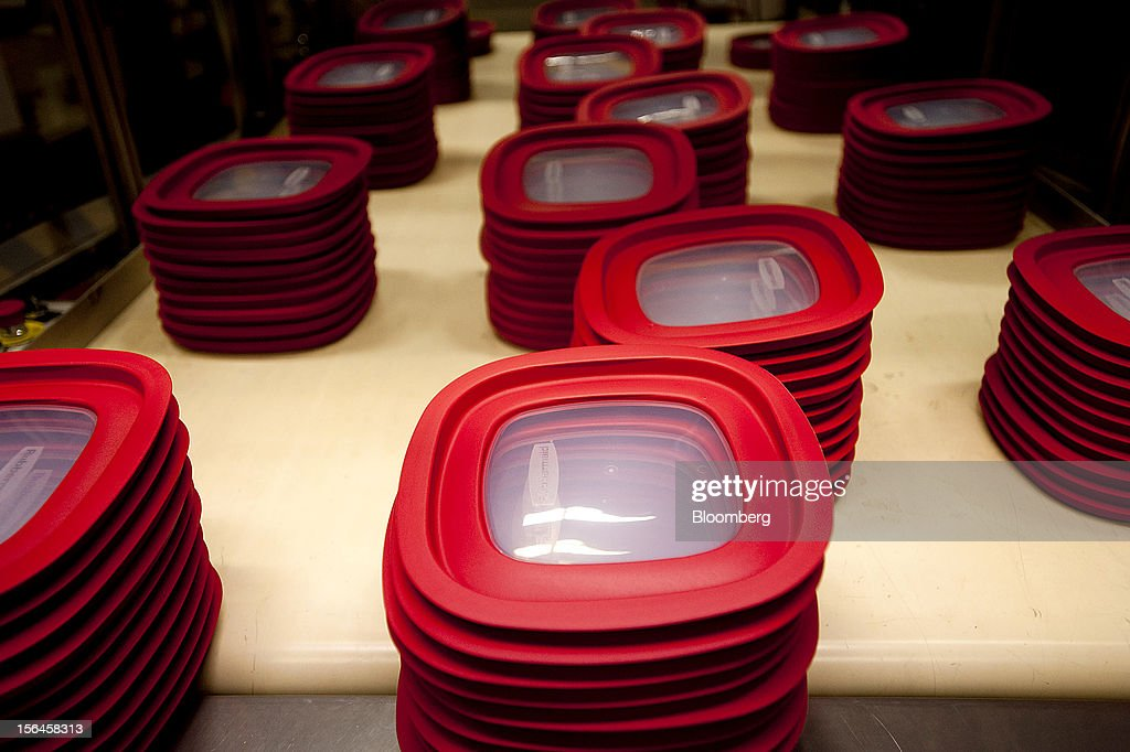 Red food container lids come down a conveyor belt after exiting a molding machine at the Newell Rubbermaid Inc. factory in Mogadore, Ohio, U.S., on Thursday, Nov. 15, 2012. The U.S. Federal Reserve is scheduled to release monthly industrial production data on Nov. 16. Photographer: Ty Wright/Bloomberg via Getty Images