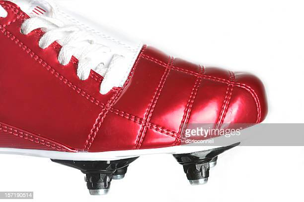 red football boots with studs