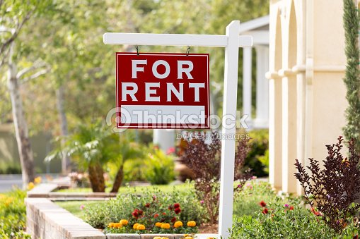 Red For Rent Real Estate Sign in Front House : Stock Photo