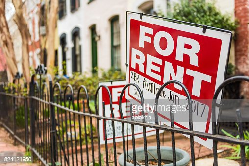 Red For Rent sign with details on front porch of house : Stock Photo
