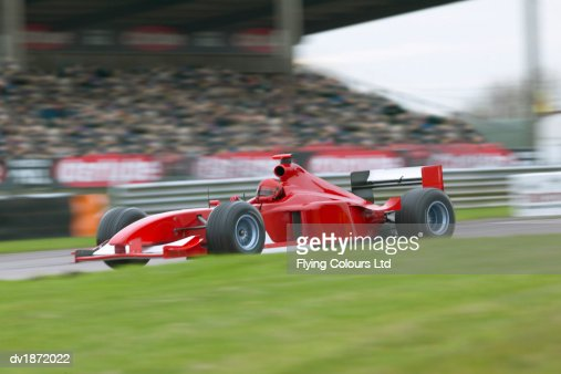 Red Formula One Car on a Racing Track : Stock Photo