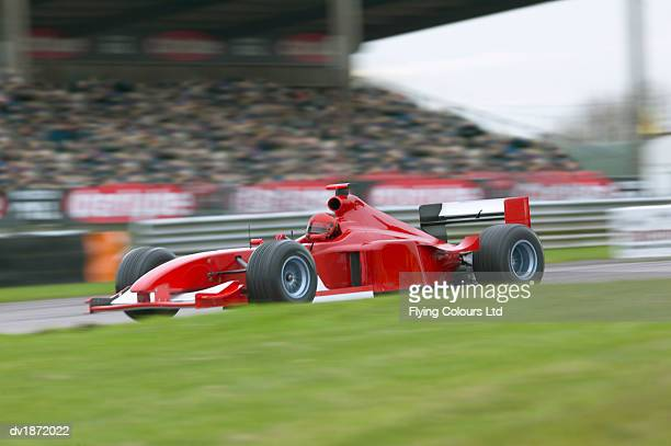 Red Formula One Car on a Racing Track