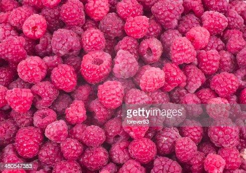 Rojo fondo de frambuesas frescas : Foto de stock
