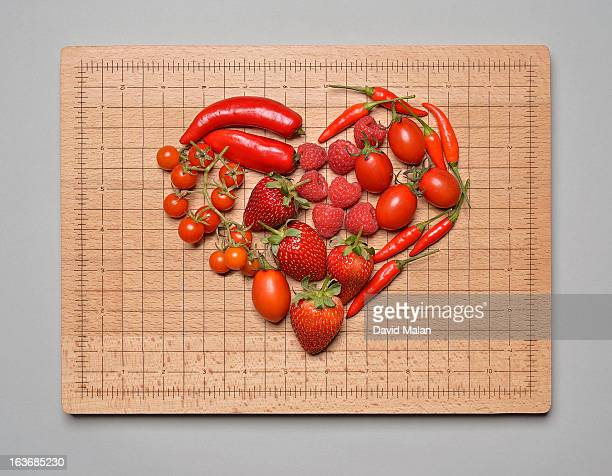 Red fruit & veg arranged in a heart shape