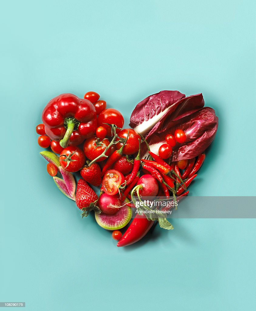 Red fruits and vegetables in the shape of a heart : Stock Photo