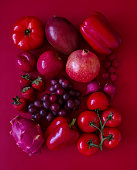 Looking down on monochrome red fruits and vegetables