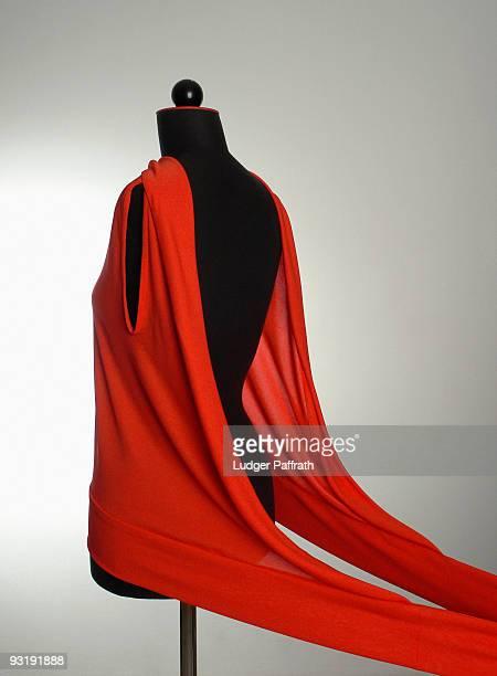 A red garment on a dressmaking model