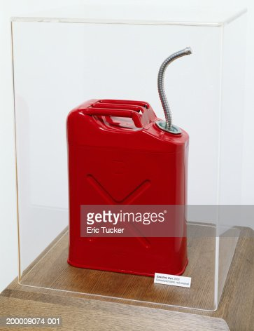 Red gasoline can in plastic display case