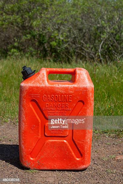 Red gasoline jug on dirt path in natual setting