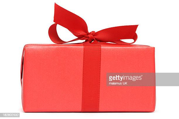 A red gift box with red ribbon