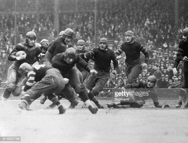 Red Grange at left trying to get through the Chicago Cardinals line in the game between the Chicago Bears and the Cardinals in Chicago when Grange...