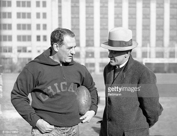 Red grange backfield star and George Halas coach and onwer of the Chicago Bears are discussing the strategy to be used in the coming professional...