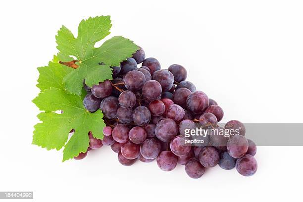 Red grape with leaves on a white background