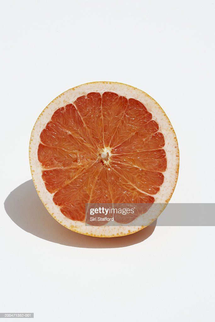 Red grapefruit cut in half : Stock Photo