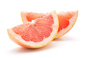 """Two red grapefruit slices isolated on white background""""n"""