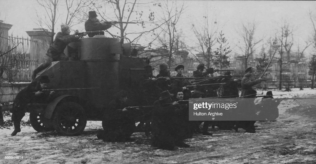 Red Guards firing from an armoured car during the Russian Revolution, Moscow, 1917. From The Russian Album.