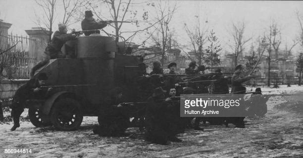 Red Guards firing from an armoured car during the Russian Revolution Moscow 1917 From The Russian Album