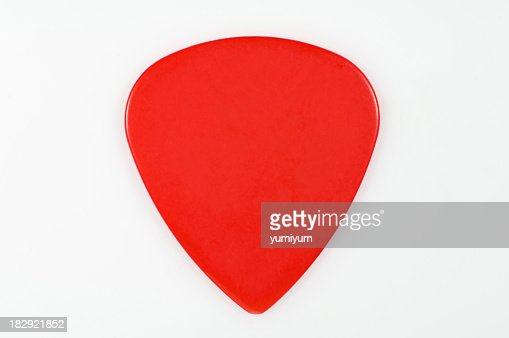 A red guitar pick on a white background