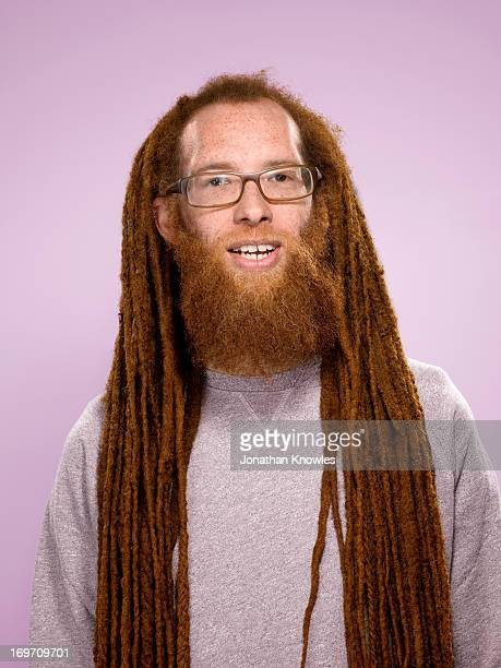 Red hair male with long dreadlocks and glasses