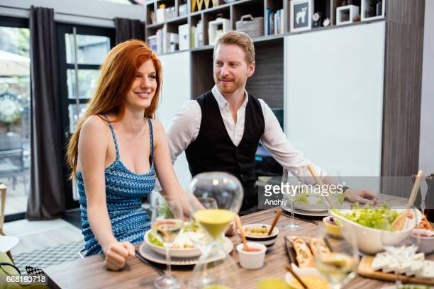 Red haired couple having a lunch.