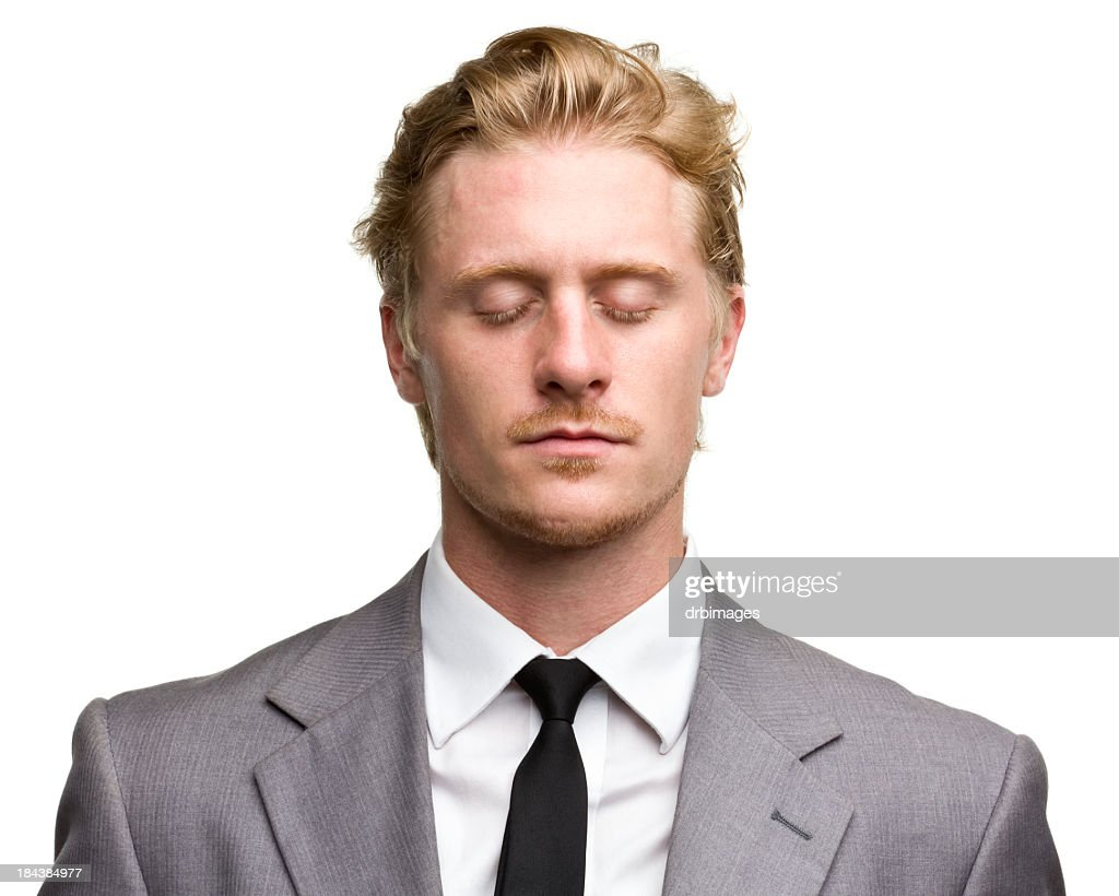 Red haired male portrait with eyes closed