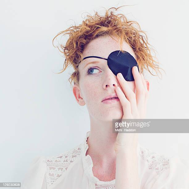 Red Haired Woman with Pirate Patch Over Eye