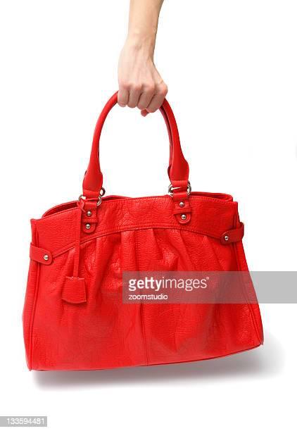 Red handbag in hand