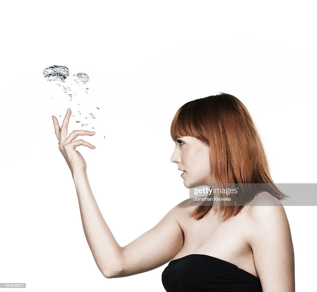 Red head female and water bubble : Stock Photo
