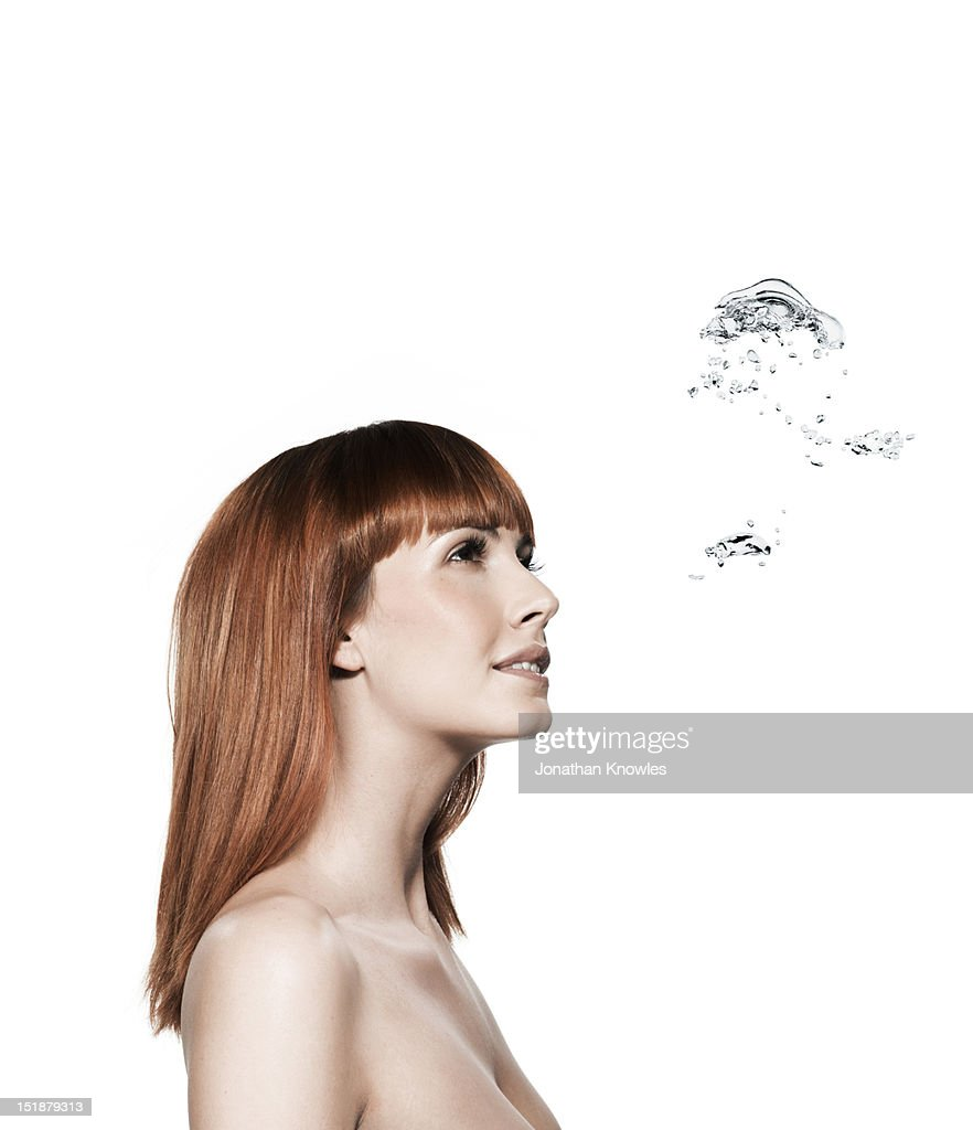 Red head female and water bubbles : Stock Photo