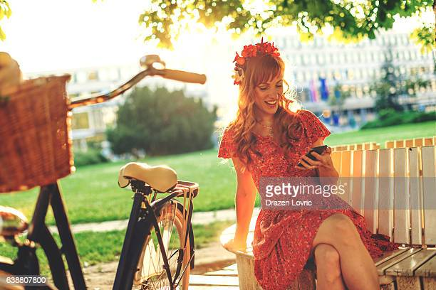 Red head woman enjoying summer afternoon in park