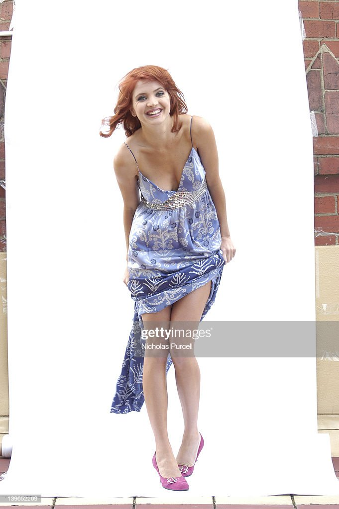 Red head woman vamps it up : Stock Photo