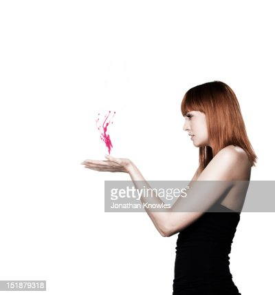 Red headed female holding pink liquid : Stock Photo