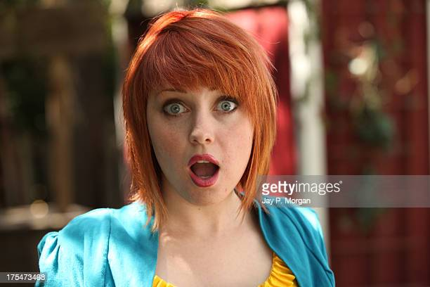 Red headed girl surprised