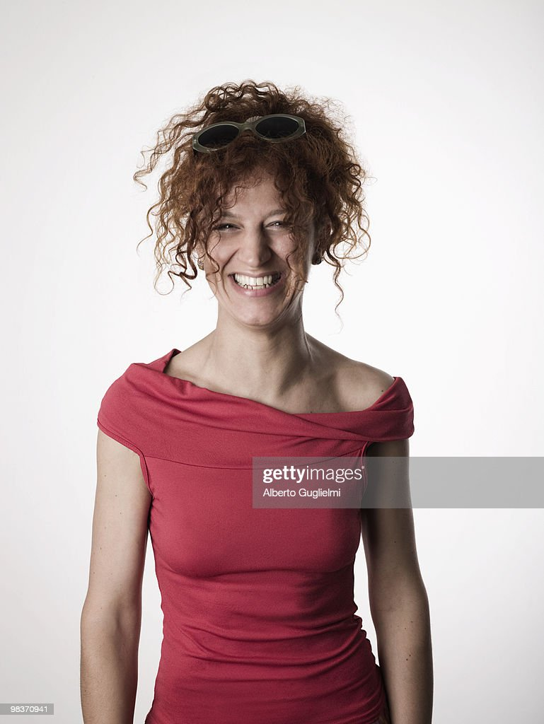 Red headed woman laughs. : Stock Photo