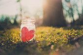 Red heart in mason jar