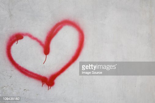 Red heart shape on white wall : Stock Photo