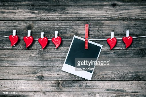 Red hearts and blank photo instant on grunge wooden background. : Stock Photo