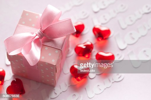 Red hearts and gift box on pink background : Stock Photo