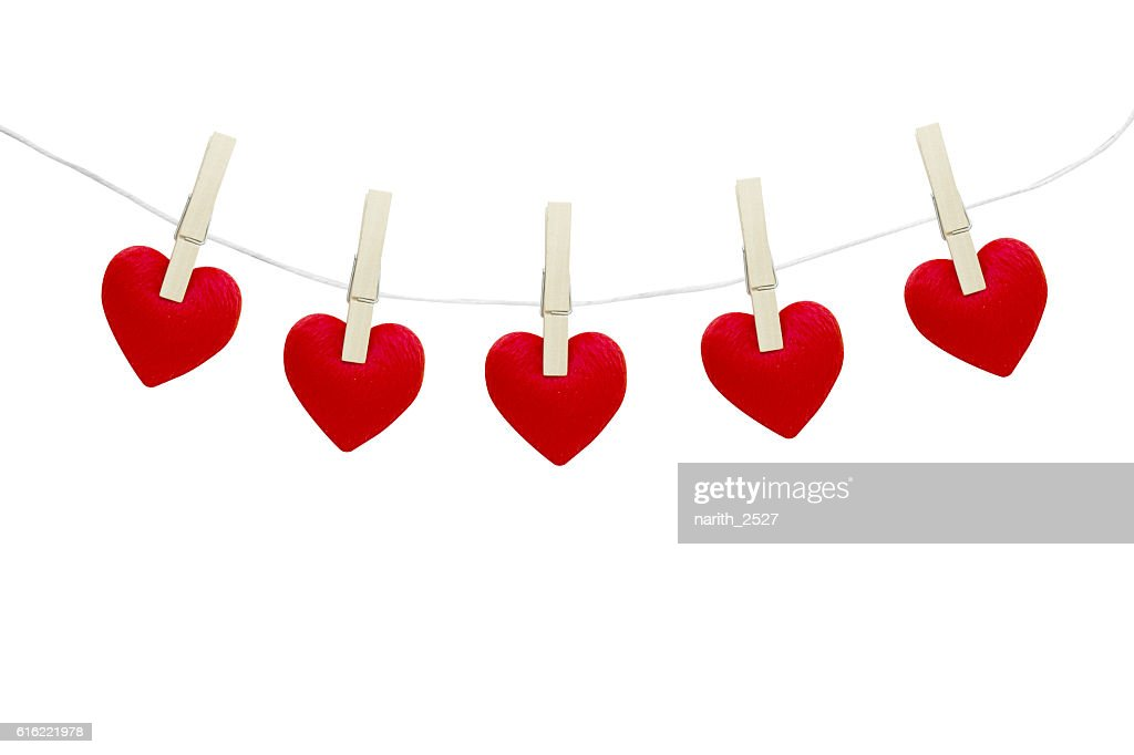 Red hearts hanging on white background : Stock-Foto