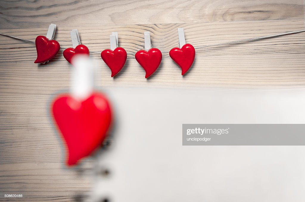 Red hearts on wooden background. Back focus. : Stock Photo